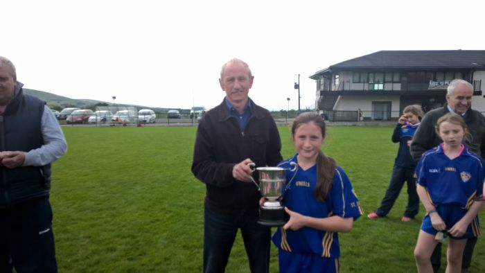 Moneyglass Captain proudly receives The Scullion Cup from Raymond Scullion