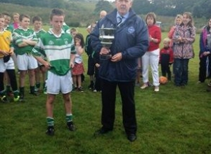 Captain Sean about to receive the trophy from Columb Walsh, South West Chairman.